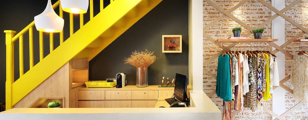 Lojas e espaços comerciais  por Thaisa Camargo Arquitetura e Interiores