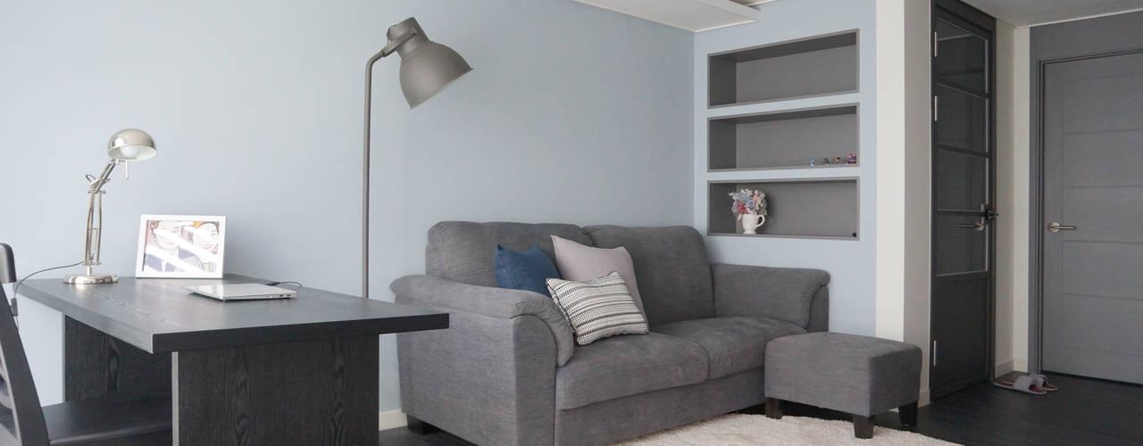 Living room by 마르멜로디자인컴퍼니,