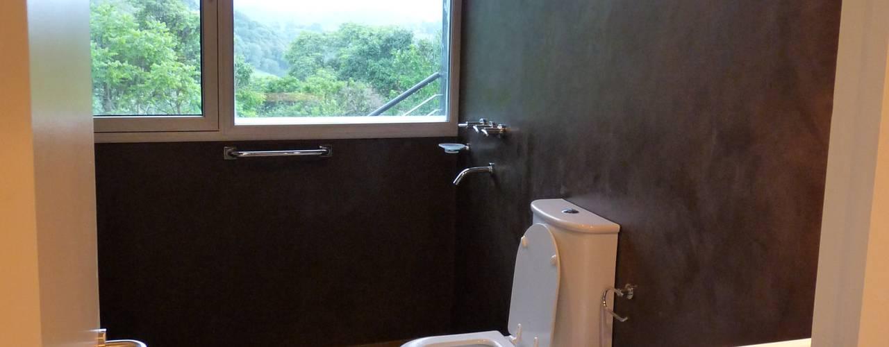 Baños de estilo moderno por ee.arquitectos