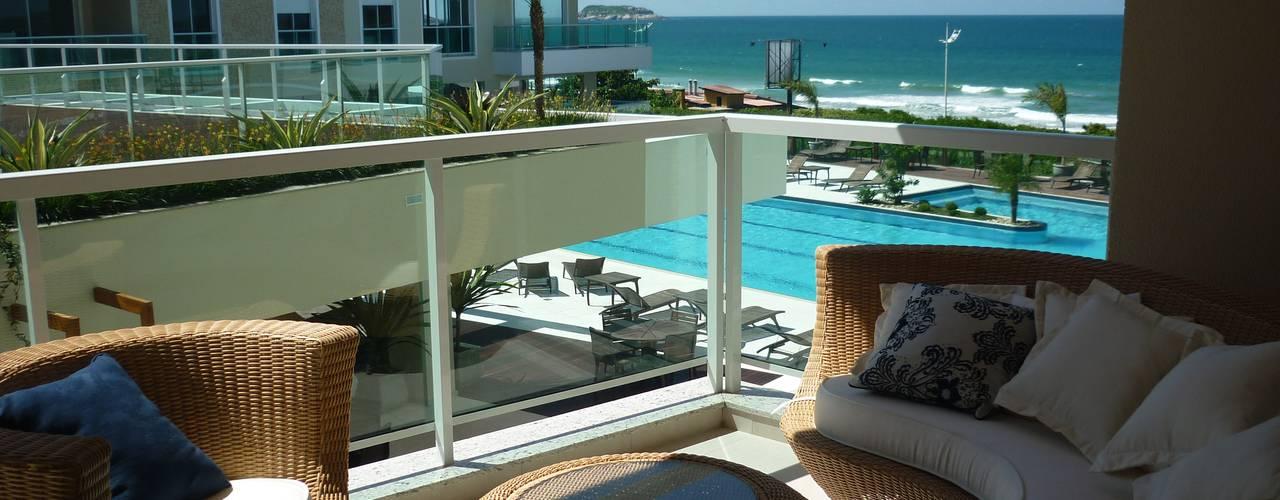 Apartamento Águas do Santinho Varandas, alpendres e terraços modernos por ANNA MAYA ARQUITETURA E ARTE Moderno