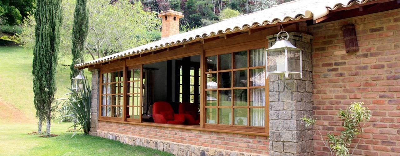 Casas de estilo  por FLAVIO BERREDO ARQUITETURA E CONSTRUÇÃO