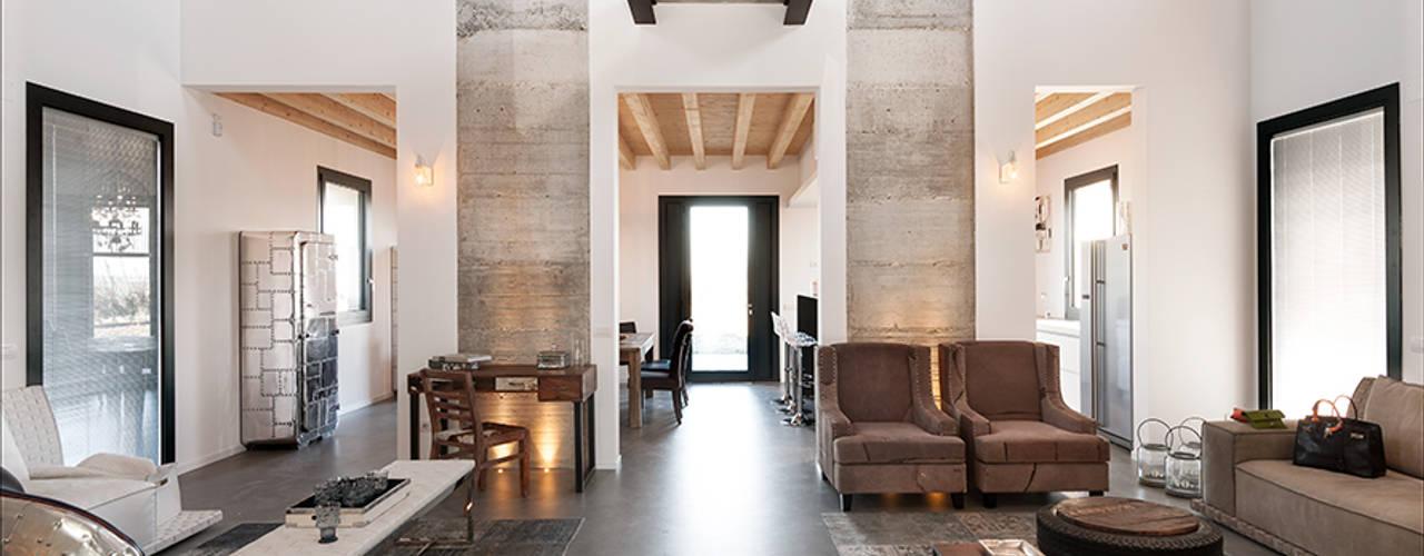 Salas / recibidores de estilo  por Resin srl, Moderno