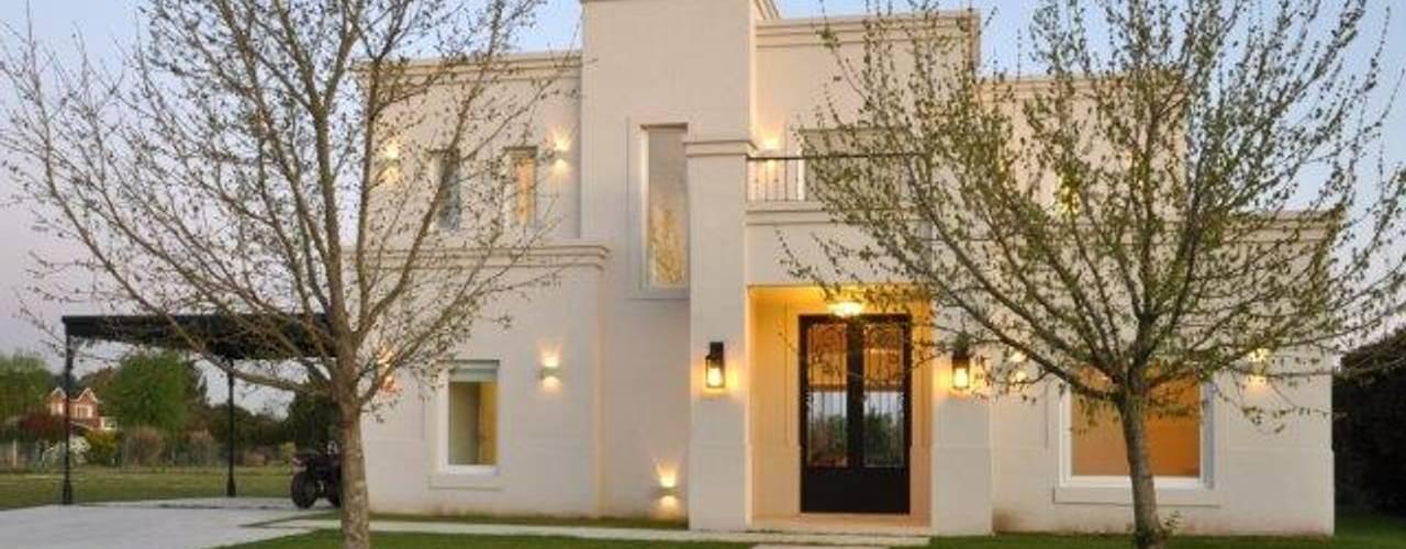 Projekty,  Domy zaprojektowane przez Parrado Arquitectura