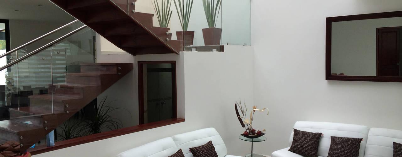 Salas / recibidores de estilo moderno por Ambás Arquitectos