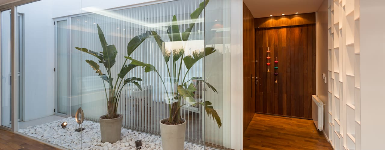 Conservatory by VISMARACORSI ARQUITECTOS