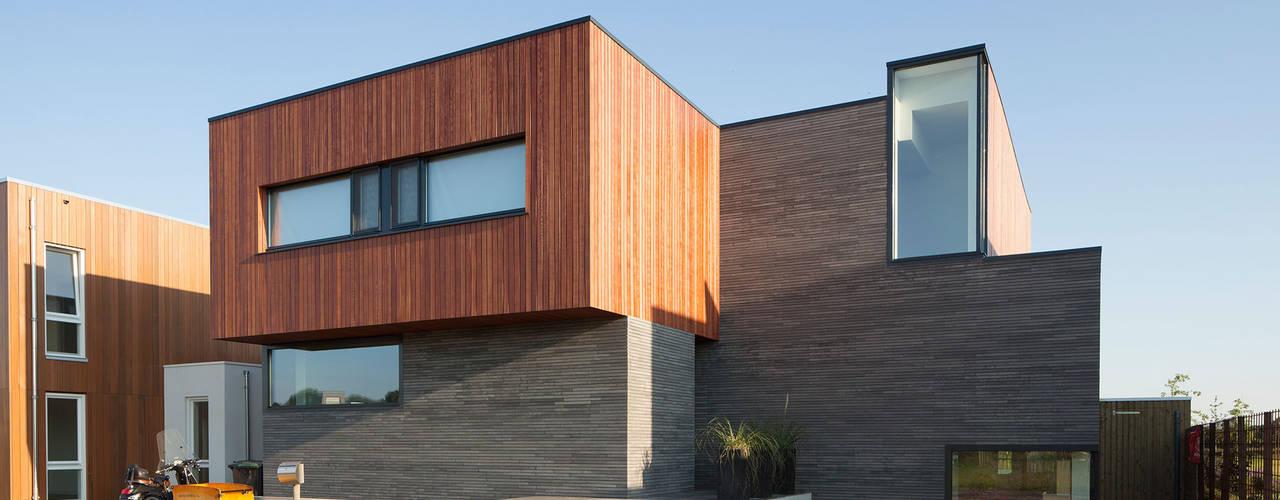 Casas de estilo  por De Zwarte Hond