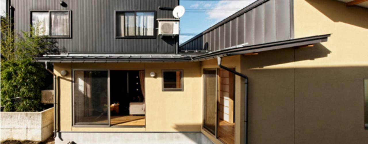 Casas de estilo  por 大類真光建築設計事務所