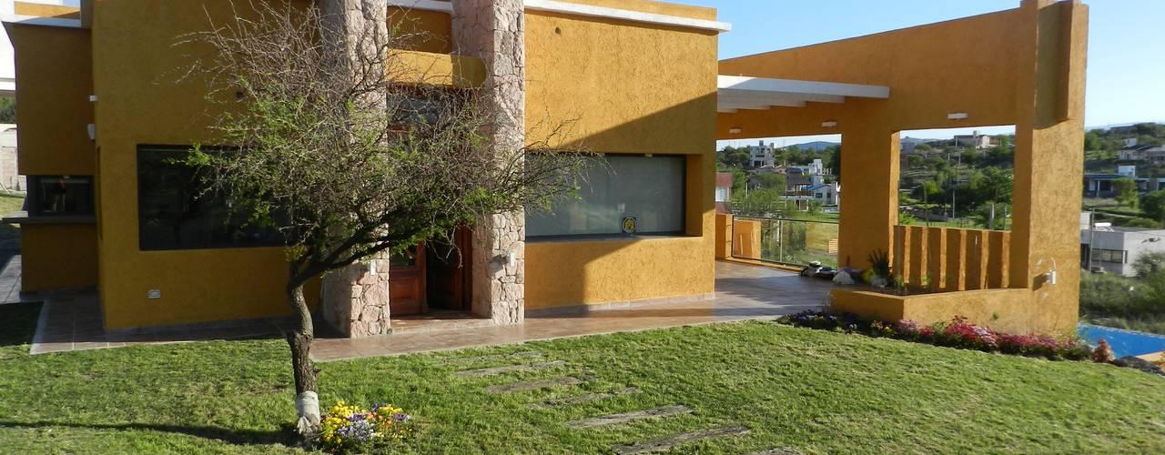 Casas estilo moderno: ideas, arquitectura e imágenes de ART quitectura + diseño de Interiores. ARQ SCHIAVI VALERIA Moderno