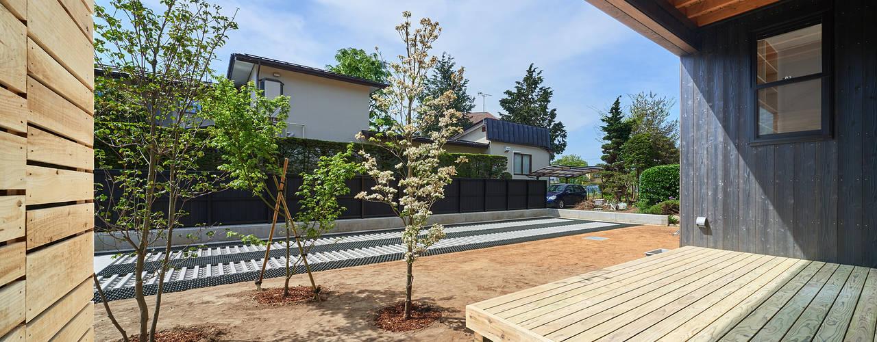 Casas de estilo moderno de 君島弘章建築設計事務所 Moderno