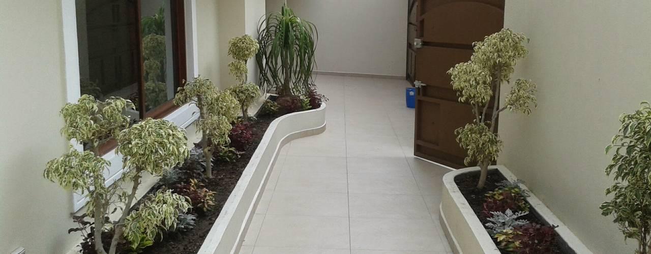 Casa JdC: Jardines de estilo  por PUNTO A PUNTO ARQUITECTURA