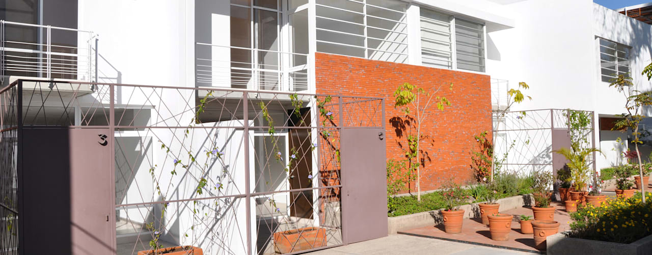 Casas de estilo  por Trama Arquitectos, Moderno