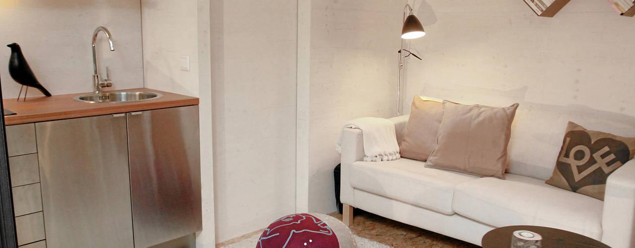 Área de Sala: Salas de estar  por Plano Humano Arquitectos