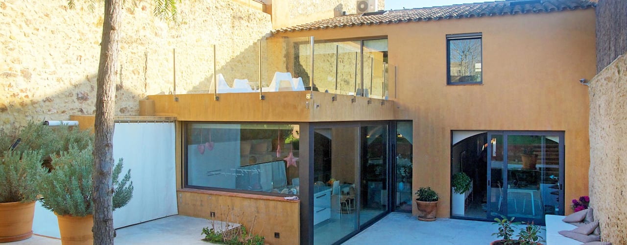 Projekty,  Ogród zaprojektowane przez Brick Serveis d'Interiorisme S.L., Śródziemnomorski