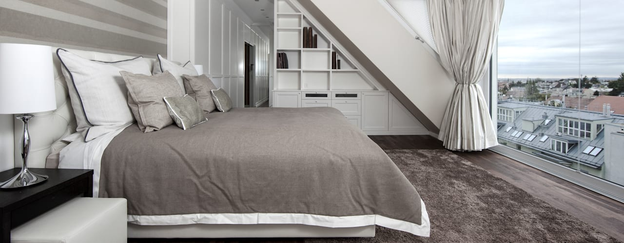 Dachgeschosswohnung:  Schlafzimmer von Cordier Innenarchitektur