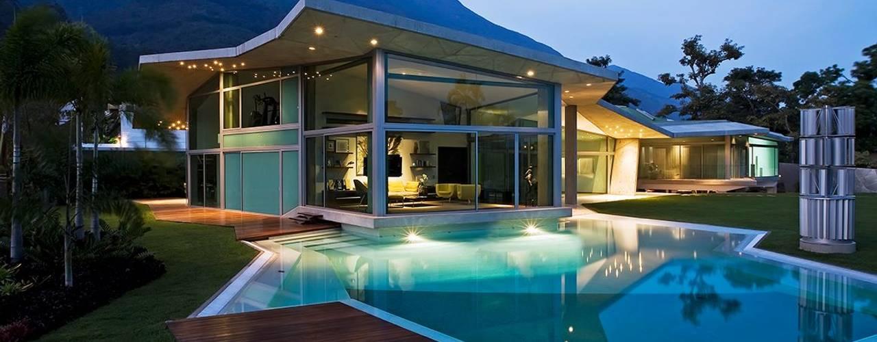 Casa AG: Piscinas de estilo  por oda - oficina de arquitectura