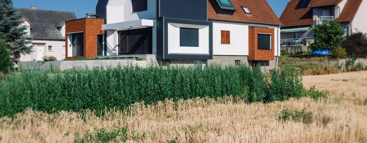 Façade Est / Sud: Maisons de style de style Moderne par [ADitude*] Architecture