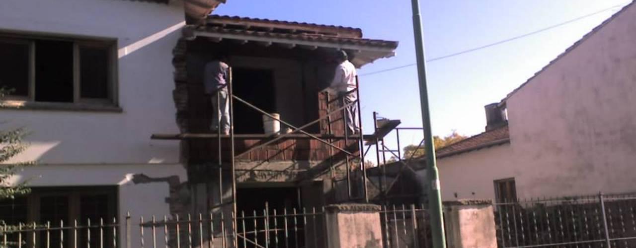 Casas de estilo  de ReformArq - Casas, reformas y ampliaciones