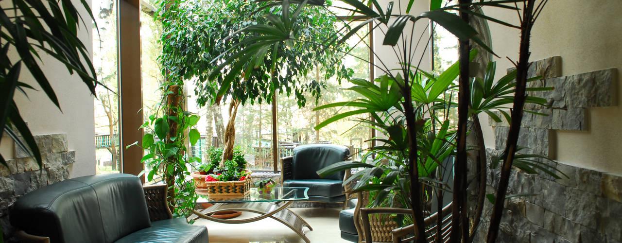 Jardins de inverno modernos por Армен Мелконян Moderno