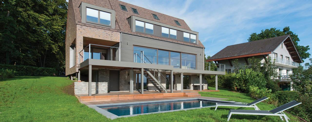 Transformation d'une habitation: Maisons de style  par BURO 5 architectes et associés