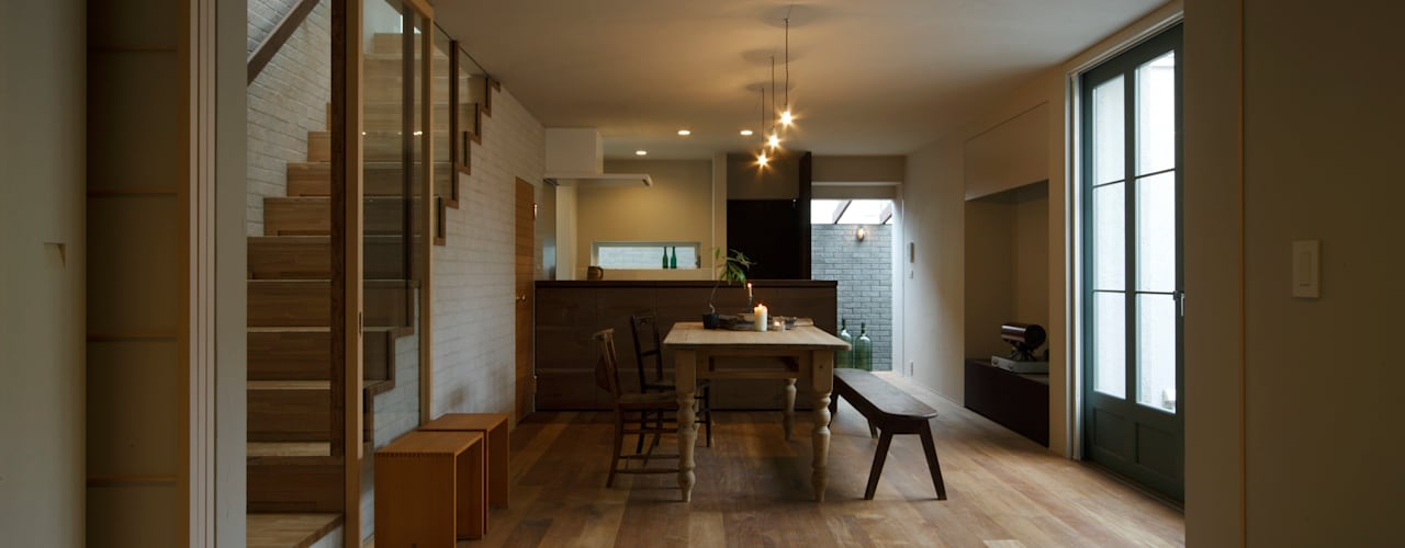 House in Minami Kounoike: Mimasis Design/ミメイシス デザインが手掛けたリビングです。
