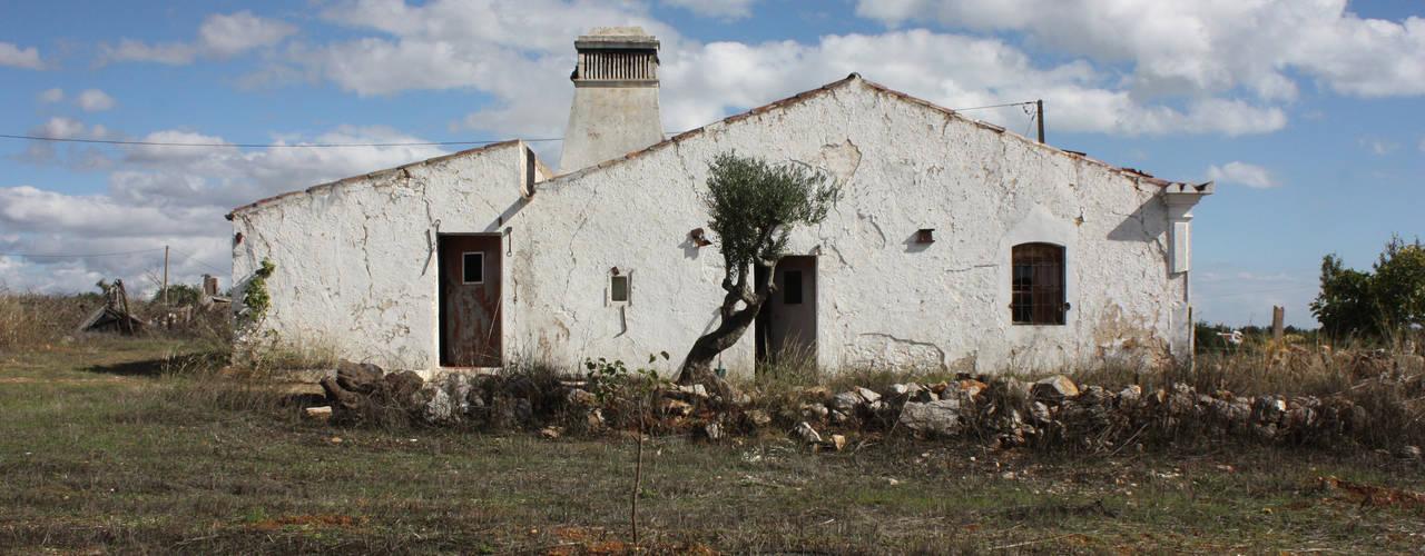 Case in stile  di atelier Rua - Arquitectos