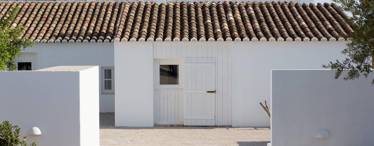 Pensão Agricola: Casas  por atelier Rua - Arquitectos