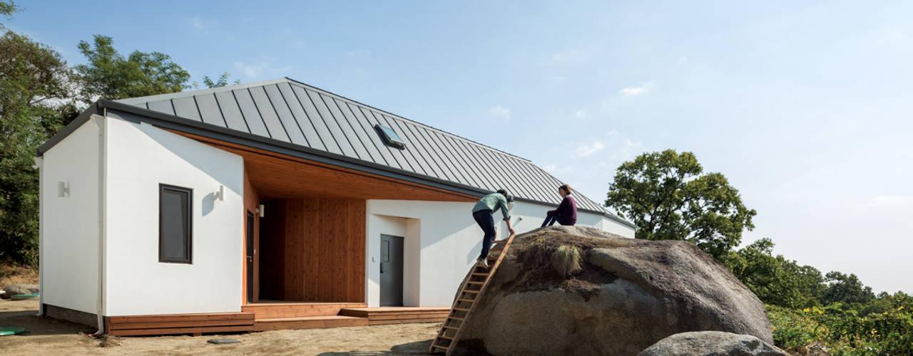 Casas de estilo  por B.U.S Architecture