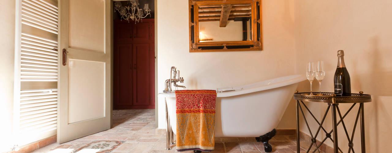 Banheiros rústicos por Ing. Vitale Grisostomi Travaglini
