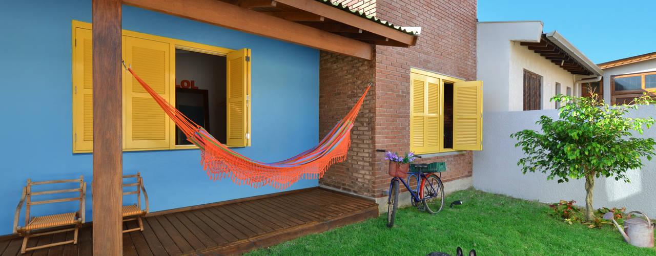 Jardines de estilo  por Arquitetando ideias