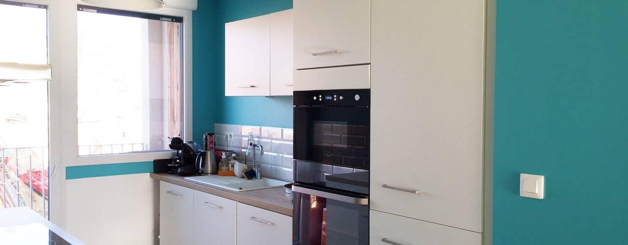 Agencement & Couleurs d'un appartement à Balma: Cuisine de style  par Mint Design,