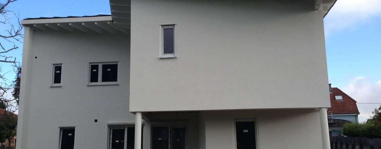 MAISON FAMILIALE EN OSSATURE BOIS: Maisons de style  par A.FUKE-PRIGENT ARCHITECTE