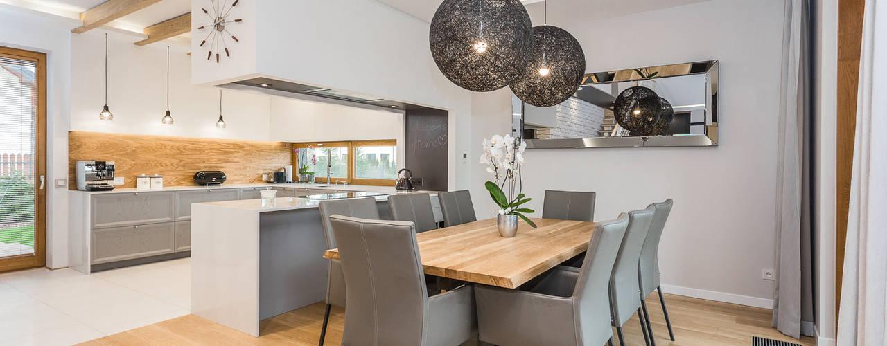 Modern dining room by Michał Młynarczyk Fotograf Wnętrz Modern
