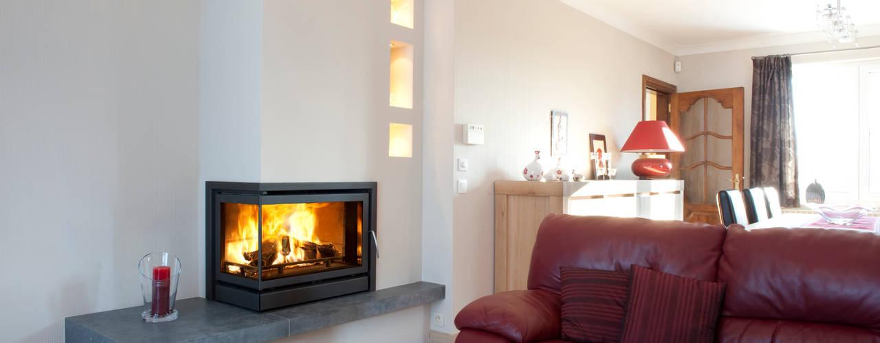Recuperadores Lenha Bodart&Gonay - In Fire (com ventilação incorporada) Salas de estar modernas por Biojaq - Comércio e Distribuição de Recuperadores de Calor Lda Moderno