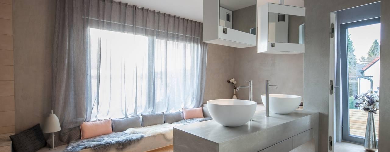 Modern bathroom by BESPOKE GmbH // Interior Design & Production Modern