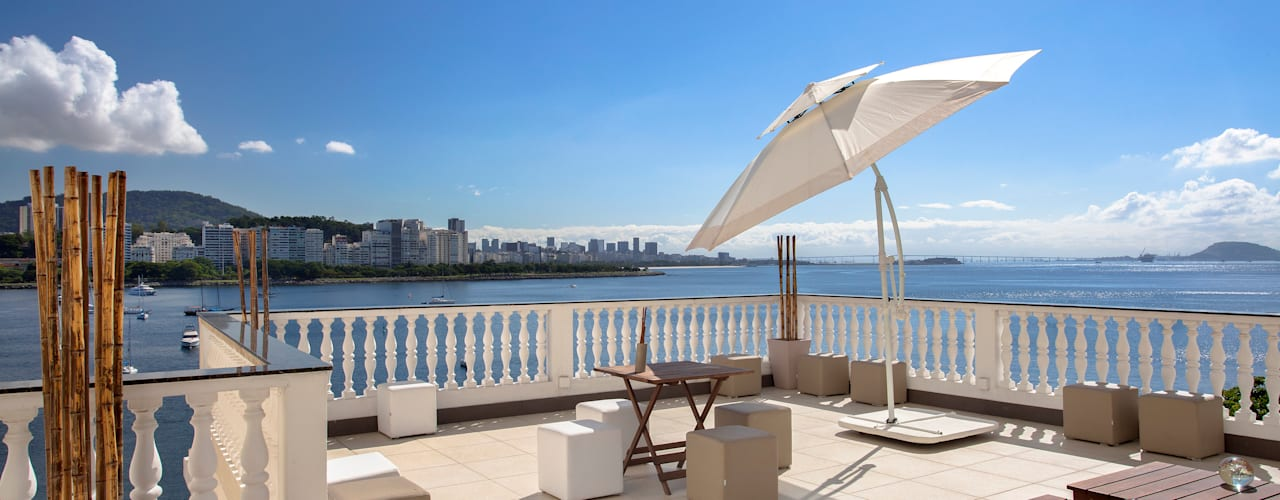 Balcones y terrazas de estilo moderno de DG Arquitetura + Design Moderno