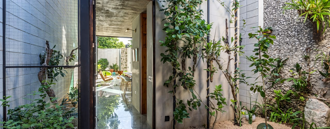 Eclectic style garden by Taller Estilo Arquitectura Eclectic