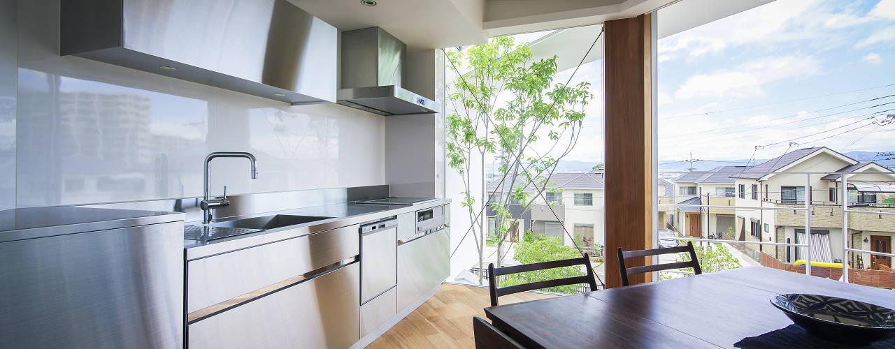 津田の家 HOUSE IN TSUDA: プラスアトリエ一級建築士事務所が手掛けたキッチンです。