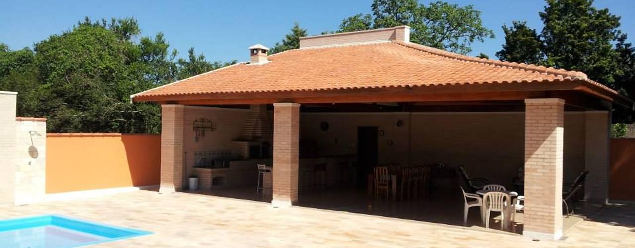 Casa de Campo Varandas, alpendres e terraços campestres por Arquiteto Lucas Lincoln Campestre