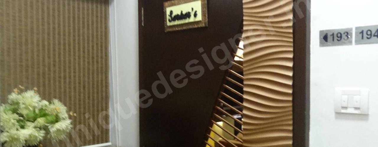 Mr. Arjit Sarkar:  Corridor & hallway by UNIQUE DESIGNERS & ARCHITECTS