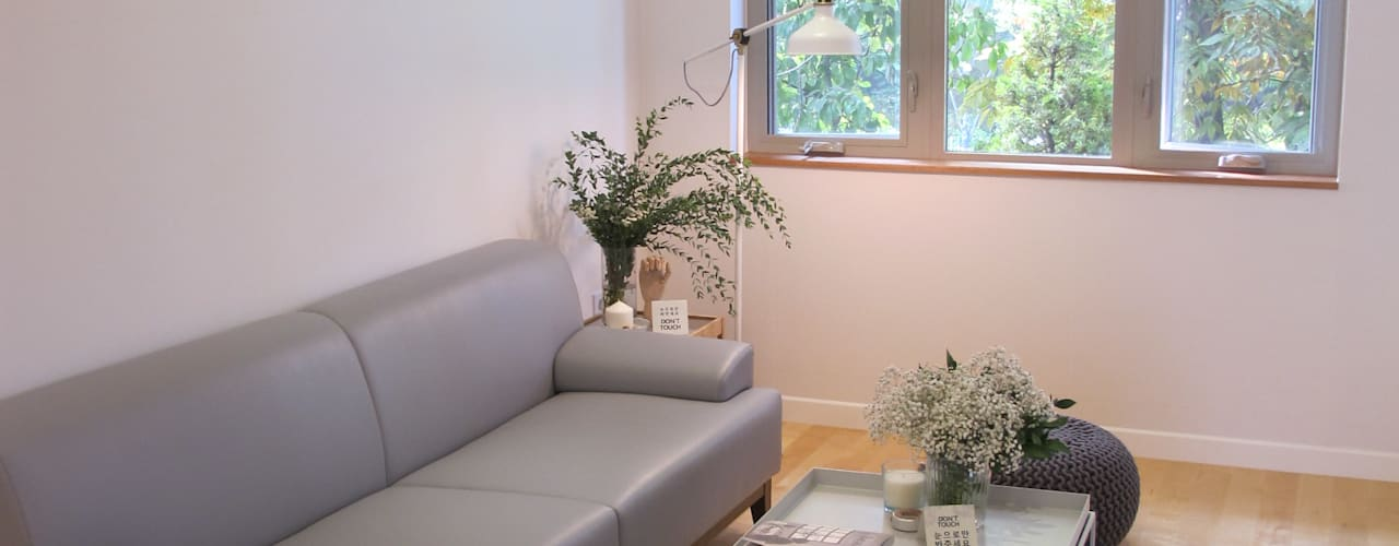 Projekty,  Salon zaprojektowane przez 루트 주택