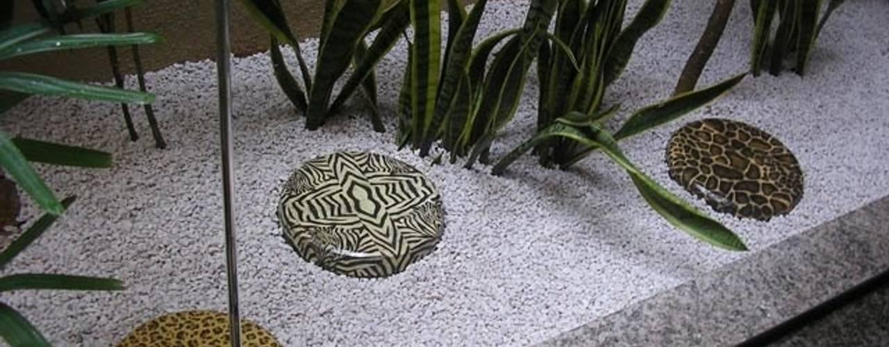 Muestras de trabajo: Jardines de estilo  por Jardines Paisajismo Y Decoraciones Elyflor