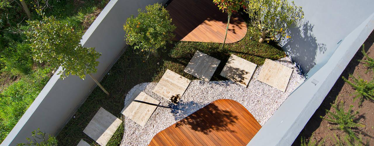 Jardines de estilo clásico de GRAU.ZERO Arquitectura Clásico
