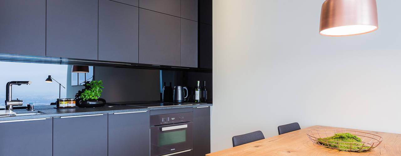 Cozinhas modernas por Michał Młynarczyk Fotograf Wnętrz