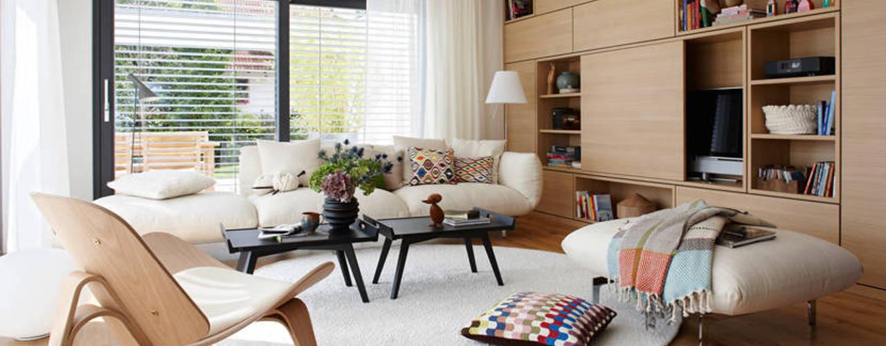 SCHÖNER-WOHNEN Haus Wohnbereich: moderne Wohnzimmer von SchwörerHaus