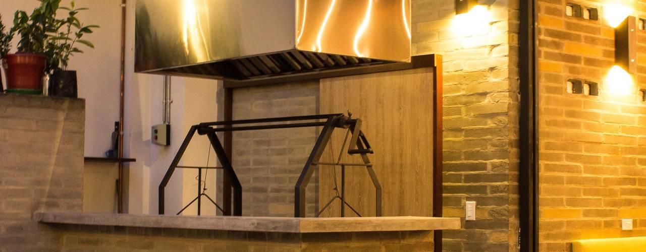 Restaurantes de estilo  por Ensamble de Arquitectura Integral
