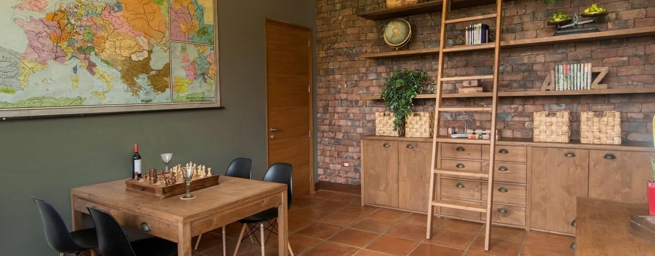 Paz y tranquilidad en el campo: Estudios y despachos de estilo  por DLPS Arquitectos