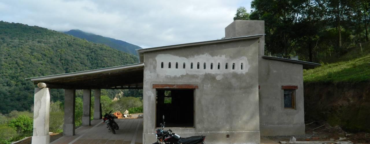 Casas de estilo rural de FERRER||AGUIRRE ARQUITECTURA+DISEÑO+MUEBLES Rural