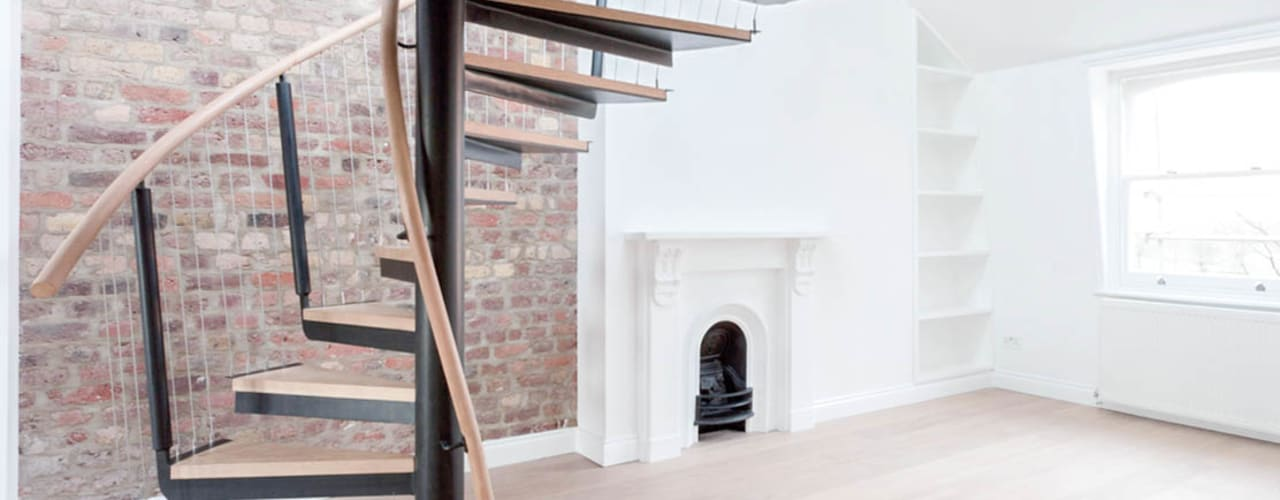 Spiral staircase to the mezzanine:  Corridor & hallway by Railing London Ltd, Modern