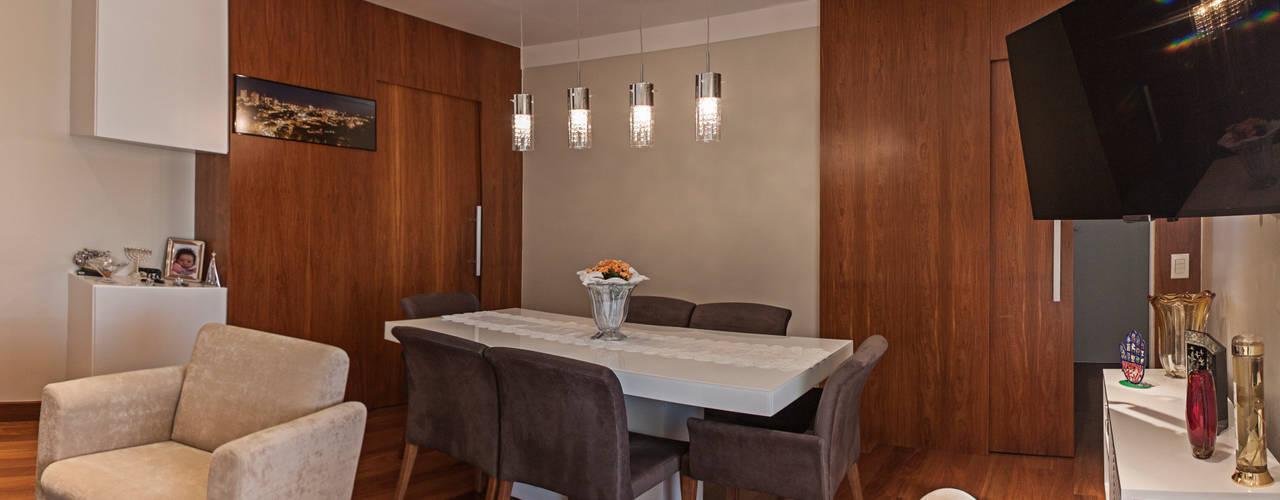 Apartamento Mnl: Salas de jantar  por canatelli arquitetura e design