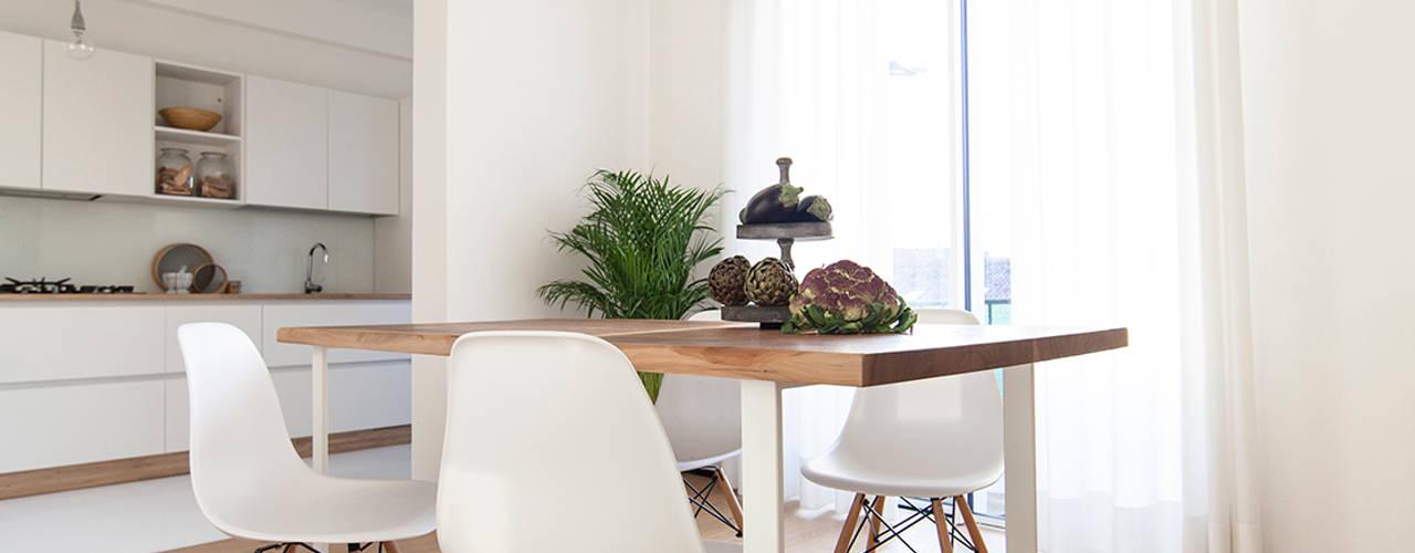 Comedores de estilo  por Didonè Comacchio Architects